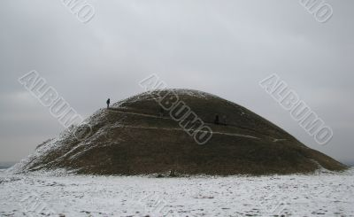 A burial mound is in fog