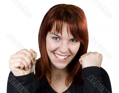 Girl smiling holding keys and expressing her happiness