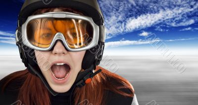 Cute girl with snowboarding helmet and goggles