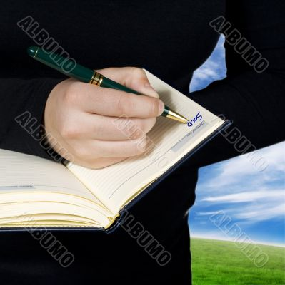 Hand writing down a note saying sold