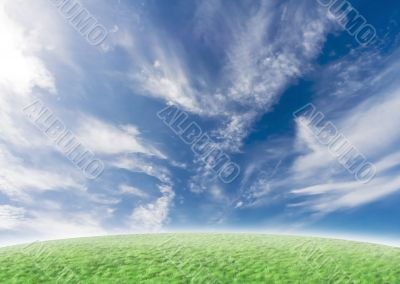 Green slope with idyllic blue sky