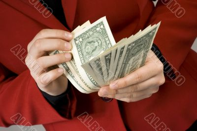 Hands counting Dollar cash