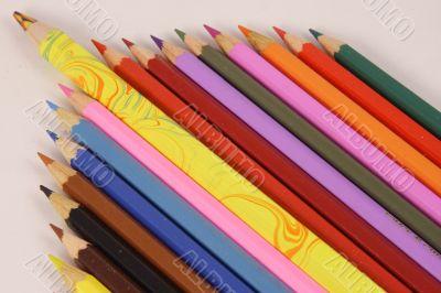 Color pencils and one big pencil