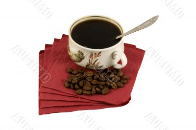 Isolated Cup of coffee on red paper with coffee-beans