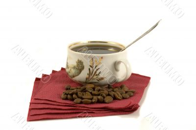 Cup of coffee on red paper with coffee-beans