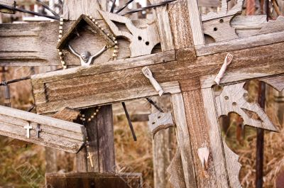 Broken Jesus figure on an old cross