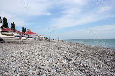 buildings on stony empty beach
