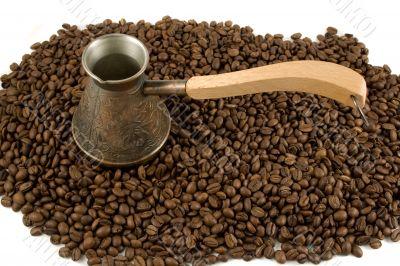 Cezve on coffee beans