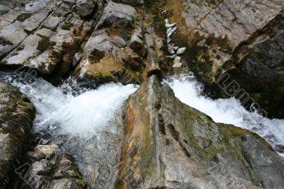 tempestuous flow of water