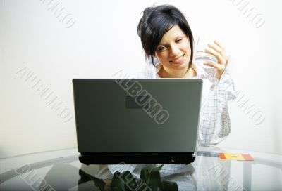 beautiful woman with laptop in mens shirt