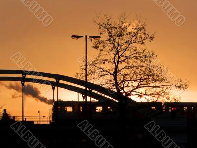 Sunrise over the train bridge