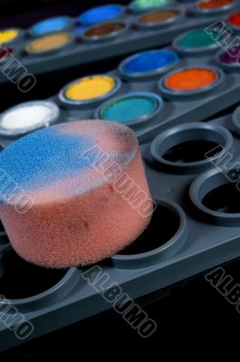 theater make-up with sponge
