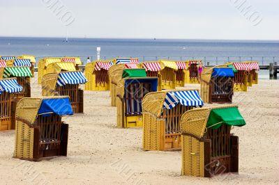 Beach wicker chairs near sea