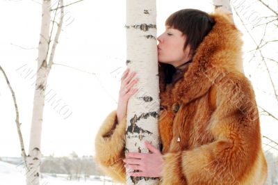 kissing birch trunk
