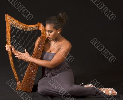 African-American woman with harp