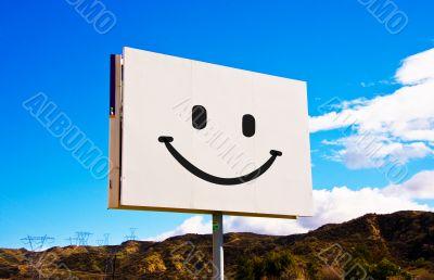 White Smiley roadside billboard