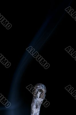 Match with smoke isolated in dark background
