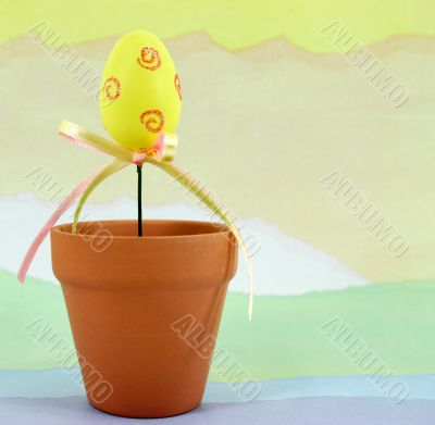 Decorated Yellow Eggs on Pastel Background