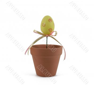 Isolated Yellow Easter Egg in Flower Pot