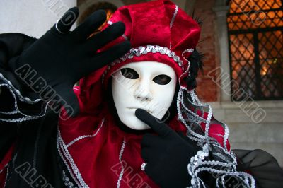 Man`s mask in a red suit.
