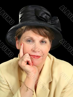 Thoughtful Woman In Hat