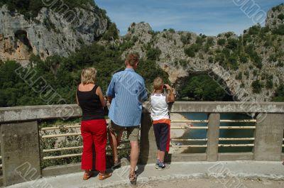 Tourists watching a Rock Bridge