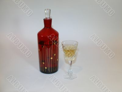 Carafe with a brandy and the filled wineglass