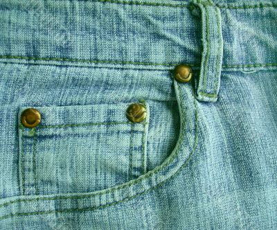 Background a jeans pocket with metal buttons