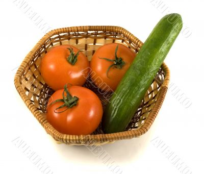 Basket with tomatoes and cucumber