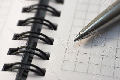 Steel pen lying on the notebook