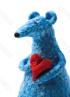 blue toy rat holding a heart in arms