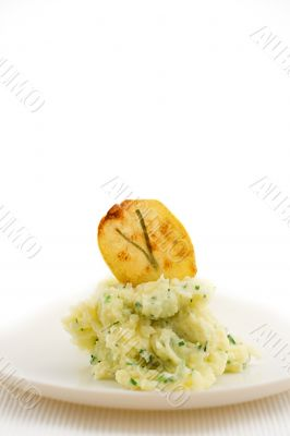 mashed potatoes with chip on plate