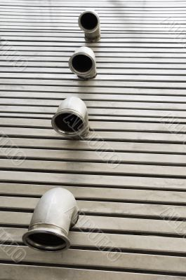 Pipes in a metal floor