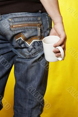 a young caucasian man with white tea cup