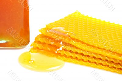 Honeycomb with honey and jar