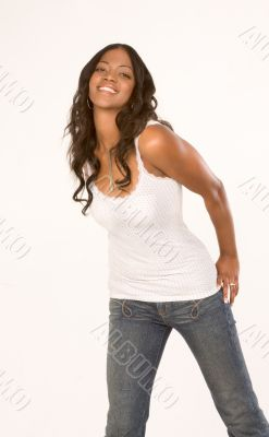 Friendly black girl in jeans and tank-top
