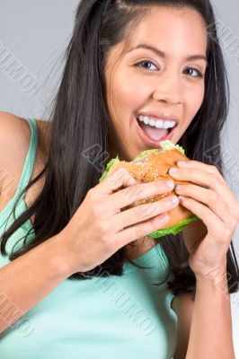 Latina girl eating burger