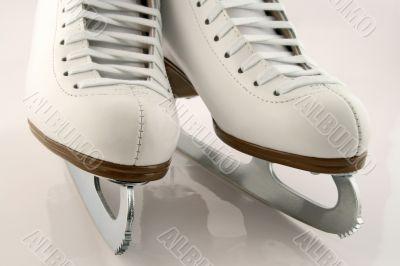 A pair of white figure skates