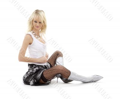 undressing blonde in silver boots