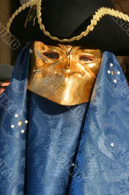 Bauta mask in dark blue suits