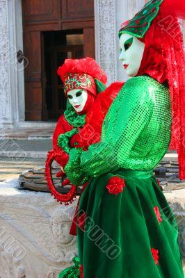 Two Venetian female masks.