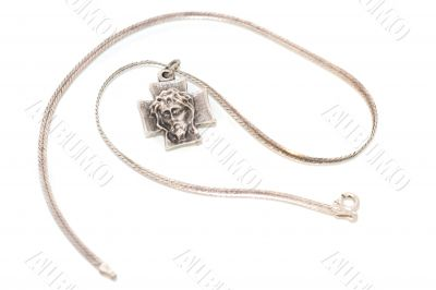 silver cross with image of Jesus