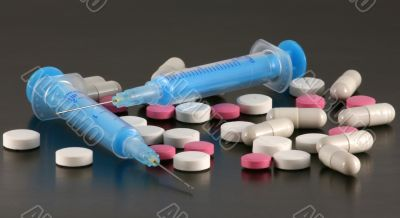 Tablets, pills and syringes