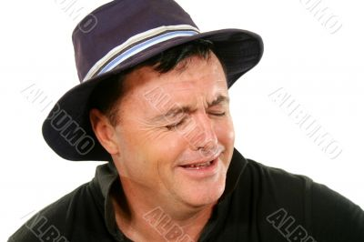 Man In Hat Crying
