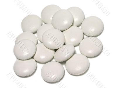 Round tablets on white background