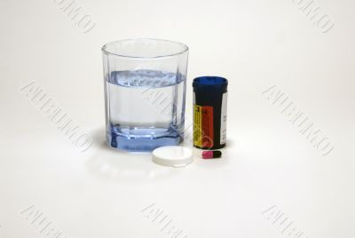 Pill with water