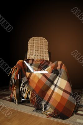 Rocking-chair and book