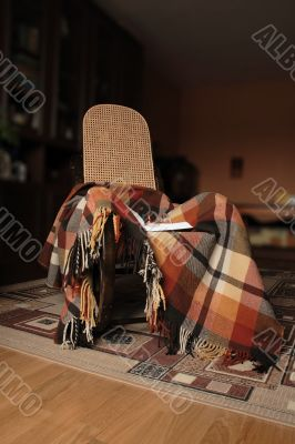 Rocking-chair and plaid