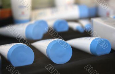 White tubes on counter.