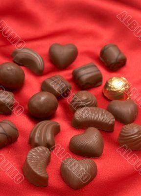 Valentines chocolates on red silk